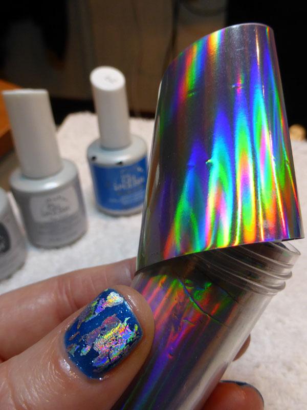 Admiring the iridescent foil