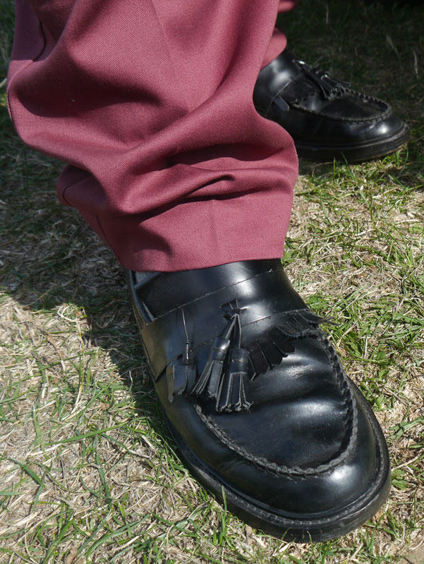 Classic black leather tassel loafers and mod standard burgundy sta-pressed trousers.