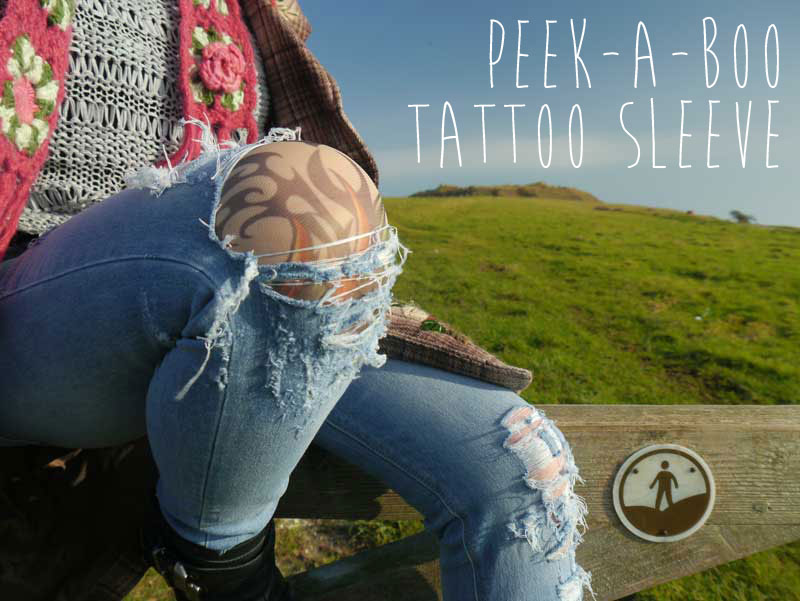 Distressed jeans - with peek-a-boo tattoo sleeve
